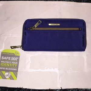 Travelon sage is protecting wallet. RFID blocking